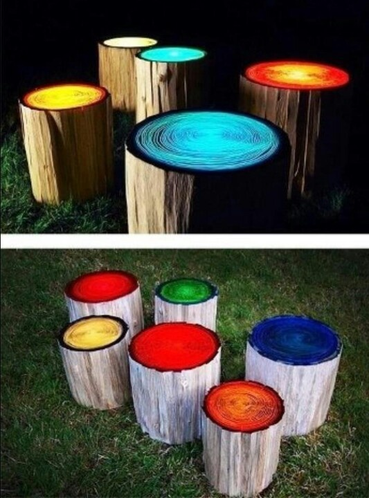 Stumps painted with glow-in-the-dark paint - perfect outdoor seating for around the fire.