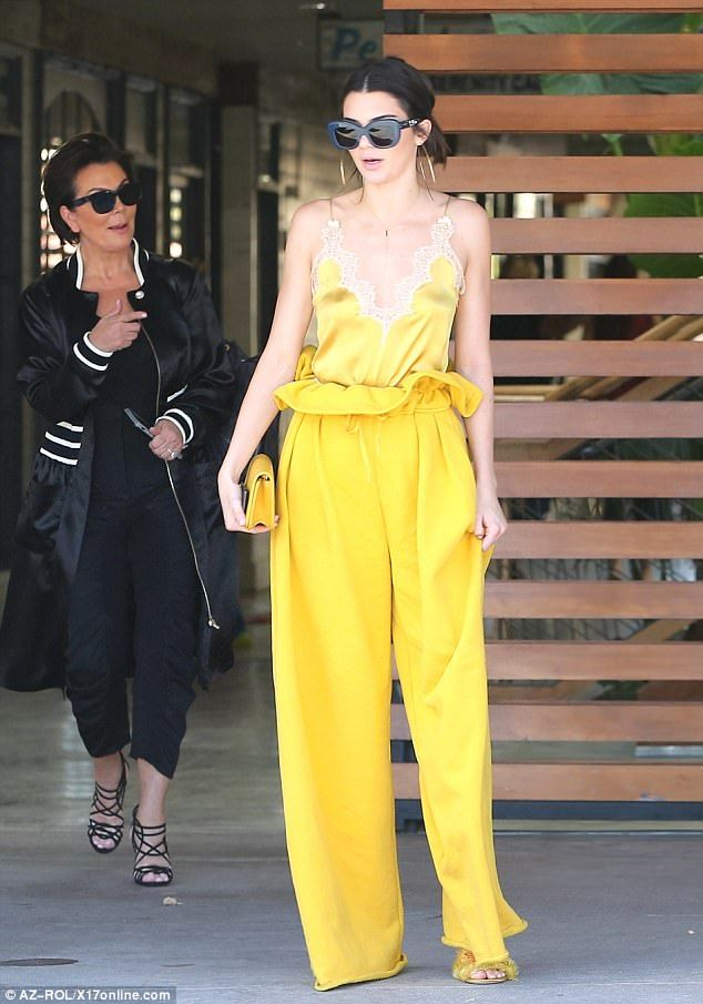 Not so mellow yellow: Kendall Jenner wowed as she went for a bite to eat with mom Kris and sister Kourtney Kardashian in Agoura Hills, California, on Wednesday