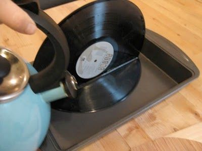 via treetrunkwise.blogspot.com  I was searching online looking for creative bookends and came upon recycled vinyl records. I found this how-...