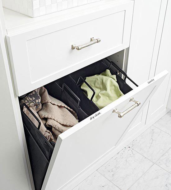 Good bathroom storage ideas. Love the hidden laundry basket.