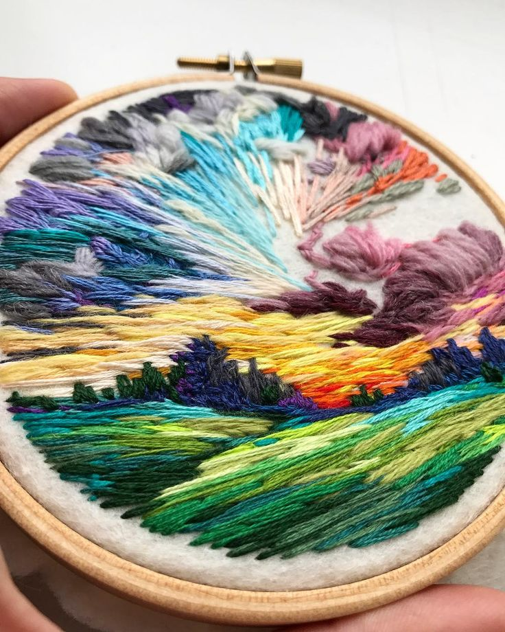 Embroidery artist paints colorful landscape scenes with thread