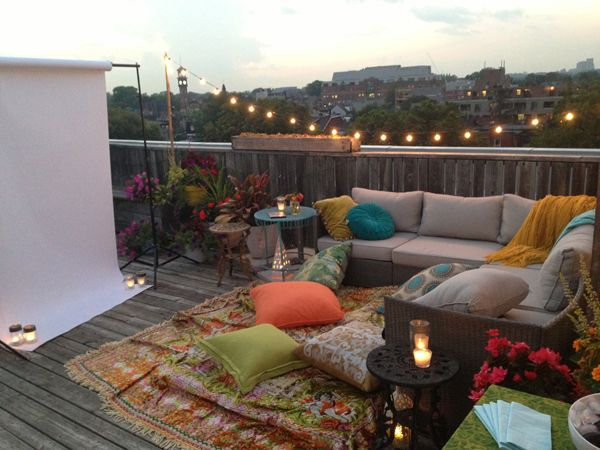 Rug on a rooftop with lots of floor pillows. Also maybe make the screen or of canvas and put it against the house?