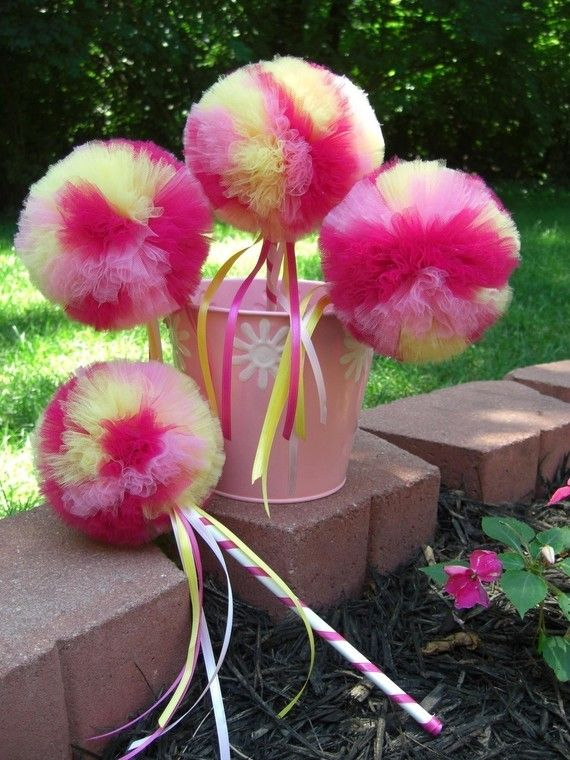 cute Each tulle pom measures 5 inches and is made from over 10 yards of tulle for extra sweet poofiness. The hand-painted wooden wand base is wrapped in ribbon and flowing ribbon streamers are also attached to the wand. All ribbon ends are sealed to prevent fraying. Everything is securely attached for tons of fun!