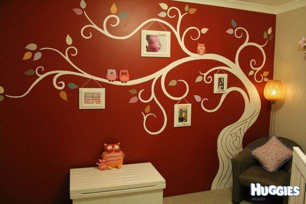 "not a big fan of the dark color, but love 1: the parents' initials in the tree trunk and 2: the picture frames ""hanging"" from the branches"