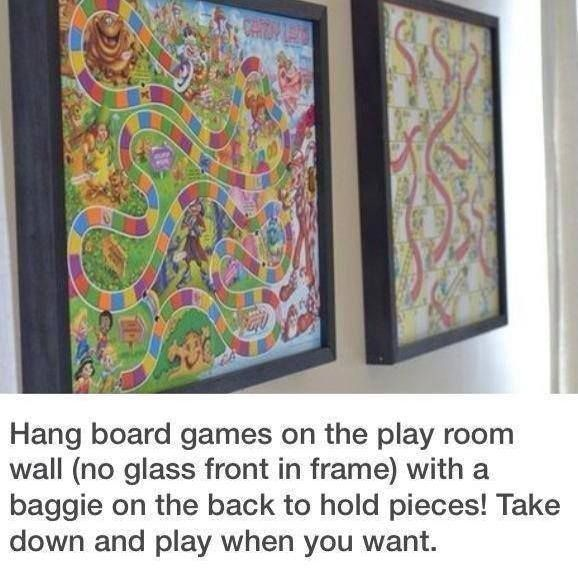 Put BOARD GAMES IN A FRAME and tape a plastic Ziploc bag to the back of frame with the game pieces! Maybe use clear plexiglass or Lexan to help protect the game board. Brilliant idea for a playroom! from:IHeart Organizing! ☼