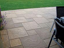 ROMANI 600 x 600 and 300 x 300 cream sands laid in dutch design