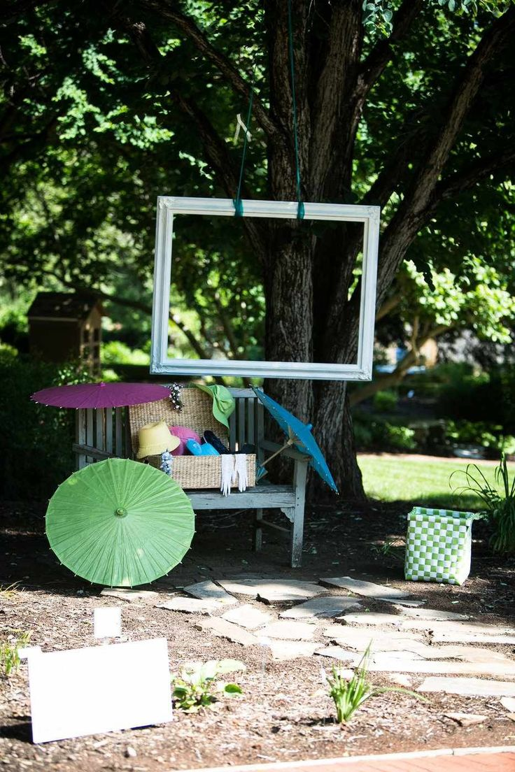 "Hang a large frame from a tree to create an inexpensive ""photo booth""! We had hats, parasols, and other props on hand, and everyone loved it!   Tags-- garden wedding, photo booth; DIY wedding; outdoor; games; reception"