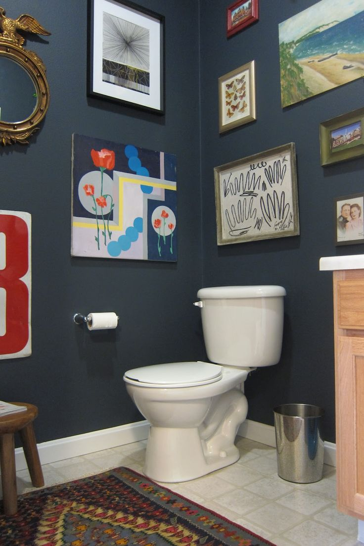 Wall Color Benjamin Moore - Blue Note 2129-30  That would be so cute to hang your children's drawings in there bathroom like that.