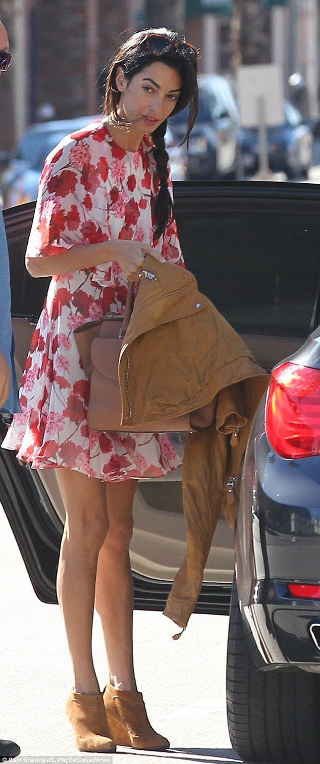 Ready for spring! Human rights lawyer Amal Clooney wore a floaty white sun dress covered in red flowers for an outing in Santa Monica