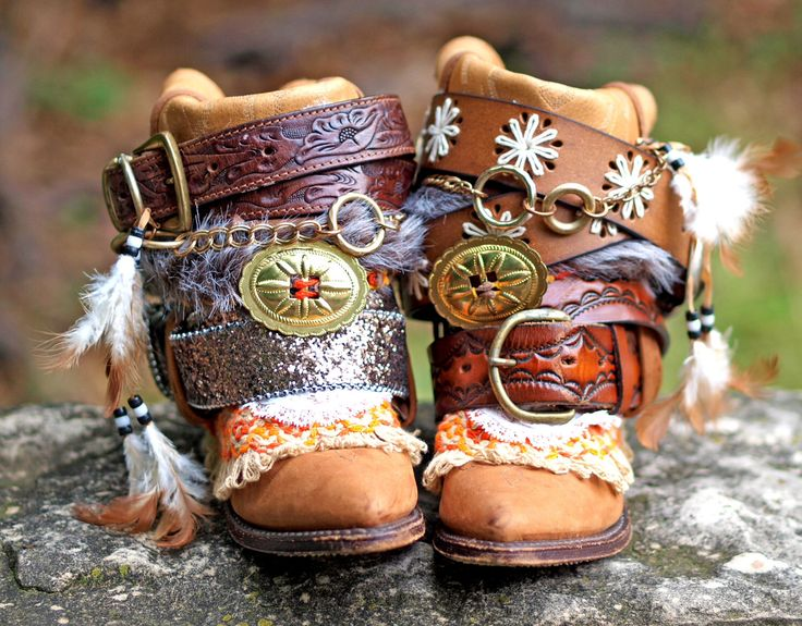 These boots are the bomb. Feathers, belts, oh my! ~Emi