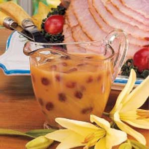 Raisin Sauce for Ham Recipe -The raisins cook up plump and soft in this savory golden sauce that will dress up ham for Easter dinner or anytime. A tart hint of lemon balances the fruit's sweetness. You can mix up this delicious accompaniment in minutes.                                                             —Lavonne Hartel                                                          Williston, North Dakota