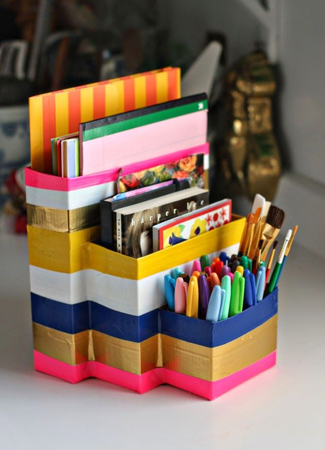 Make an affordable, DIY back-to-school supply organizer out of boxes you have at home! Add colorful striping with bands of duct tape.