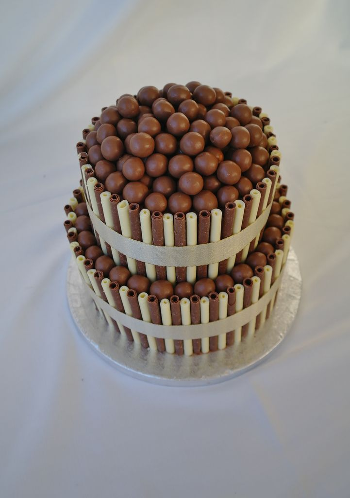 """https://flic.kr/p/9hN35c   Two Tier Chocolate Wedding Cake   Two tier chocolate wedding/celebration cake, decorate with milk and white chocolate cigarellos and Maltesers. <a href=""""http://www.thereforthebaking.com"""" rel=""""nofollow"""">www.thereforthebaking.com</a>"""
