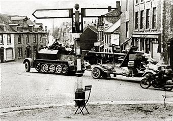 A German 88 mm gun towed by a half track through a village on the western front during World War II, 1940. Germany's victory in France in 1940 followed the 'Phoney War', (September 1939 - April 1940) and the German breakthrough accomplished at great speed meant France was forced to surrender in June 1940. Pin by Paolo Marzioli