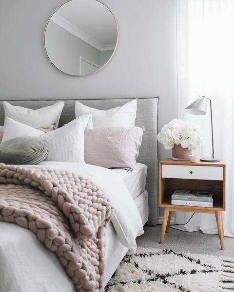 This bedroom has many of the hallmarks of enviable Scandinavian style: grays, whites, wood, minimalism, muted colors, and plenty of wool. This cool-yet-cozy hygge from Down Under can be yours with just a few trips to Target, IKEA and H&M, no plane ticket required.