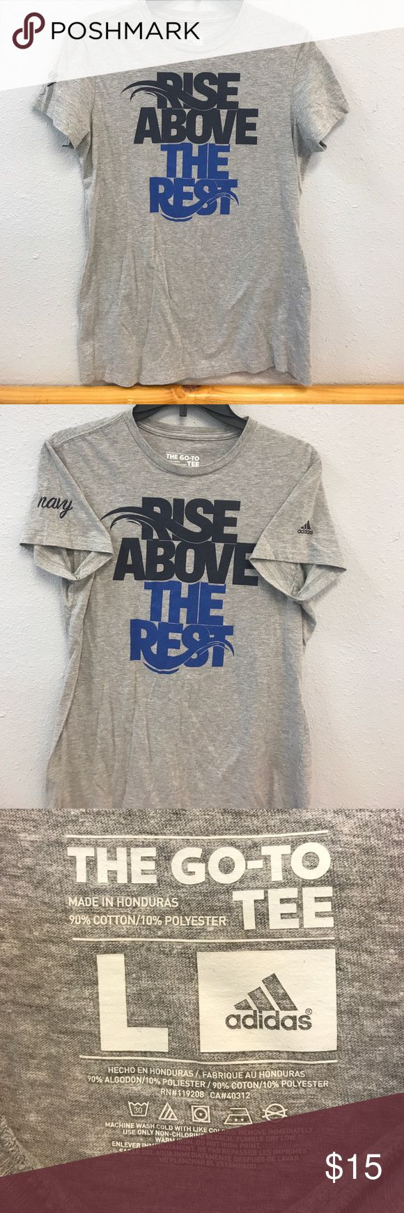 Women's Adidas Go-To Tee Rise above the Rest screen-printed on this heather grey Women's Adidas Go-To Tee. Navy is printed in the right sleeve, adidas logo on the left as shown in pic 2. Item is used but still in great shape. Size Large Adidas Tops Tees - Short Sleeve