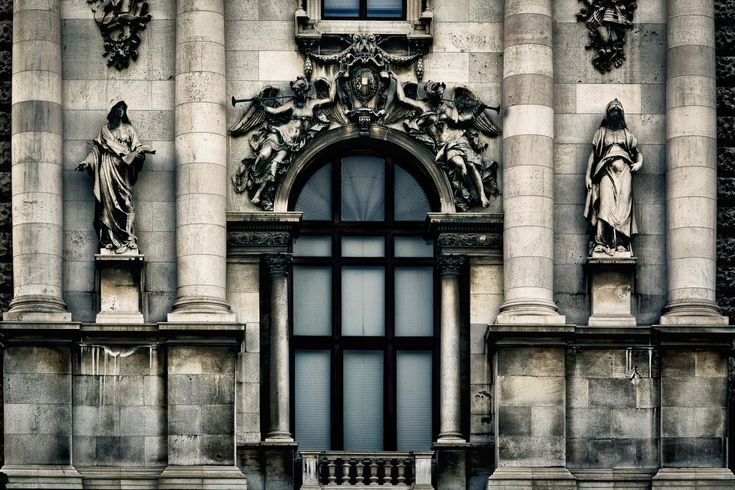 A detailed view of a section of the facade of the Austrian Parliament in Vienna, Austria