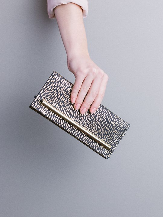 Symmetry collection by Georgie Cummings  Flip wallet in black with fur gold foil print