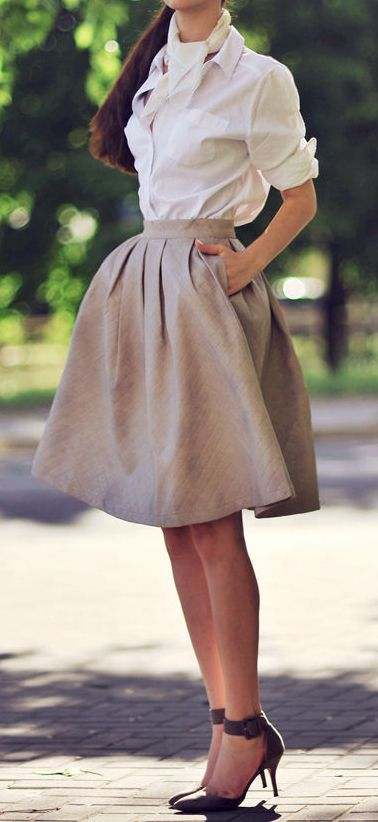 for the warmer fall days - a voluminous skirt and tailored shirt with flats or heels. Can wear with tights or a cardigan in the winter.