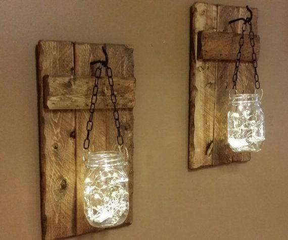 These adorable Sets of Candleholders have hanging mason jars with battery operated led firefly lights. Made from Rustic reclaimed wood and are stained Early American . You can order with Firefly lights or ( No Lights) Each candle holder will be unique in itself and have its on Unique features. It may have cracks, holes, knots, dark and light spots. Each will be one of a kind. No 2 will be identical. The actual holders are approx. 7 1/2 x 14 1/2. They come with a Pint size jars and hang from…
