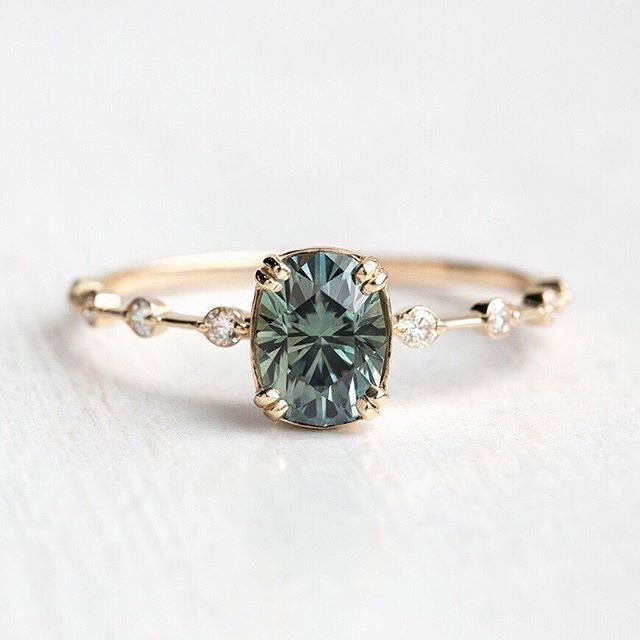 Delicate blue engagement ring