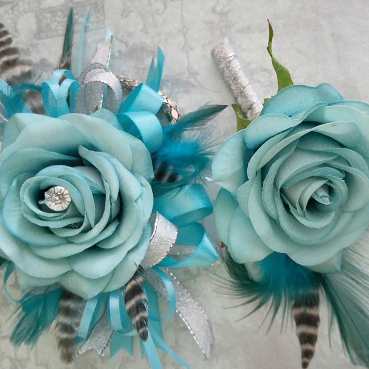 New listing today! Real touch roses paired with some dramatic striped feathers- perfect for prom!!