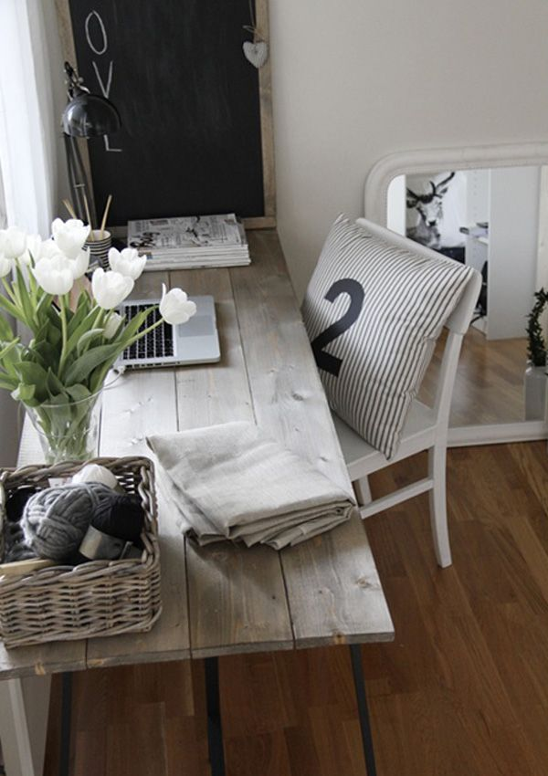 Chic Reclaimed Wood Office Desk chic home office features a rustic wood sawhorse desk paired with an oatmeal linen rolling task chair placed atop a white rug with dark blue thin stripes Chic Diy Computer Desk Ideas Rustic Deskreclaimed Wood