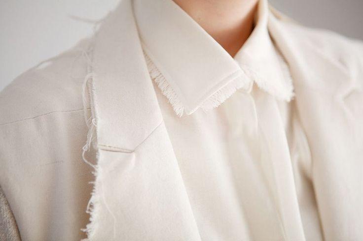 Jacket & white shirt with frayed collar detail; sewing inspiration; close up fashion design detail