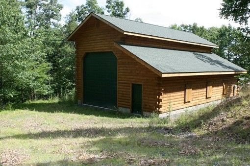 Amazing acres with a 44 39 x 28 39 log rv garage for Log cabin garages for sale