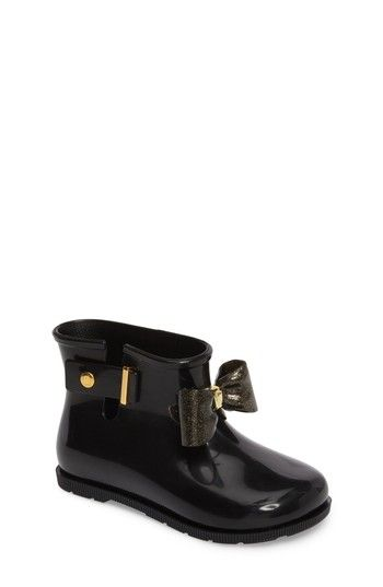 Free shipping and returns on Mini Melissa 'Mini Sugar' Rain Boot (Walker & Toddler) at Nordstrom.com. A darling, oversized bow lends a playful touch to puddle-ready rain boots crafted from flexible, recyclable PVC.