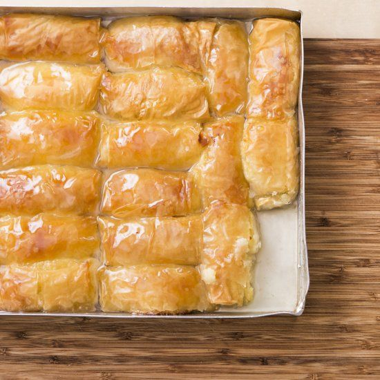 Galaktoboureko - Greek pastry of custard cream filled phyllo rolls, baked, then drenched in syrup, like Baklava.