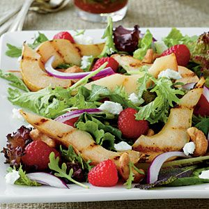 Grilled pear salad with raspberries, honey-roasted nuts, crumbled goat cheese and a raspberry vinaigrette