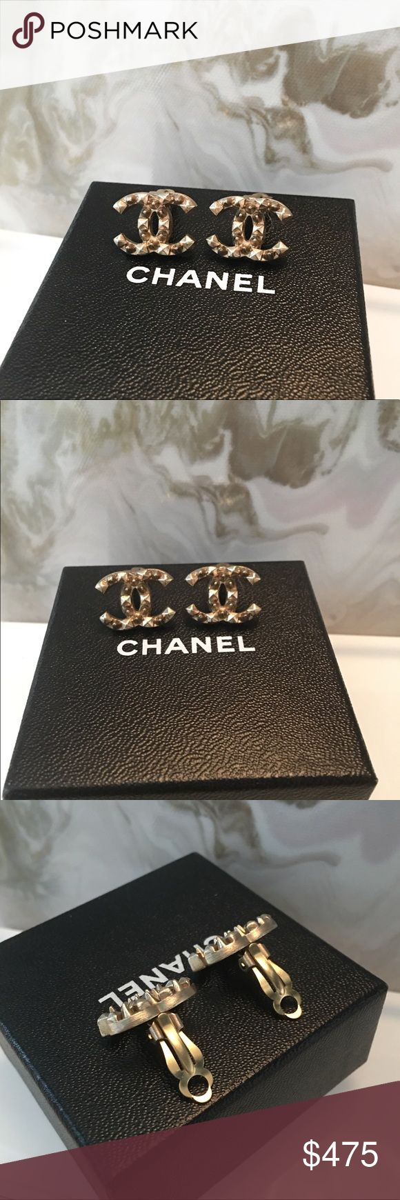 """Auth Chanel Studded Light Gold CC Stud Earrings Authentic Chanel Studded CC Clip On Earrings. Very light Brushed gold metal with square and round studs throughout. Love the rockstud feel on these!! 100% authentic, stamping on the back. Clips need pads as shown, does not come with box. Measures approx W 0.7 """" x H 0.6 """". Very good condition. I love Clip ons because they don't droop on your ear and can be adjusted to your ear. CHANEL Jewelry Earrings"""