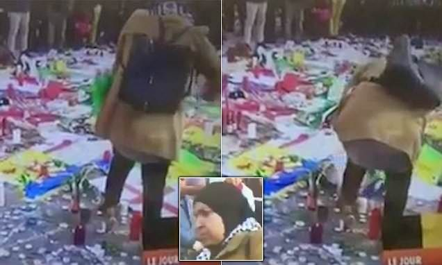 This is the shocking moment a woman removes an Israeli flag from a Brussels memorial and rips it up. A French-language station captured the footage, taken atthe Place de la Bourse.