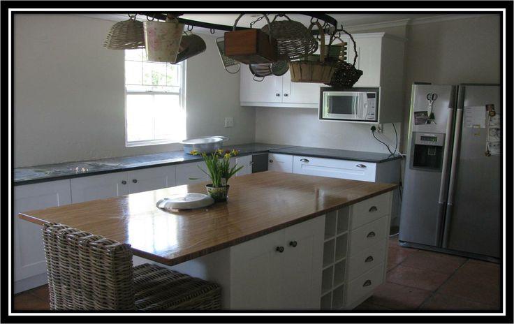 MDF sprayed kitchen with solid bamboo worktop.