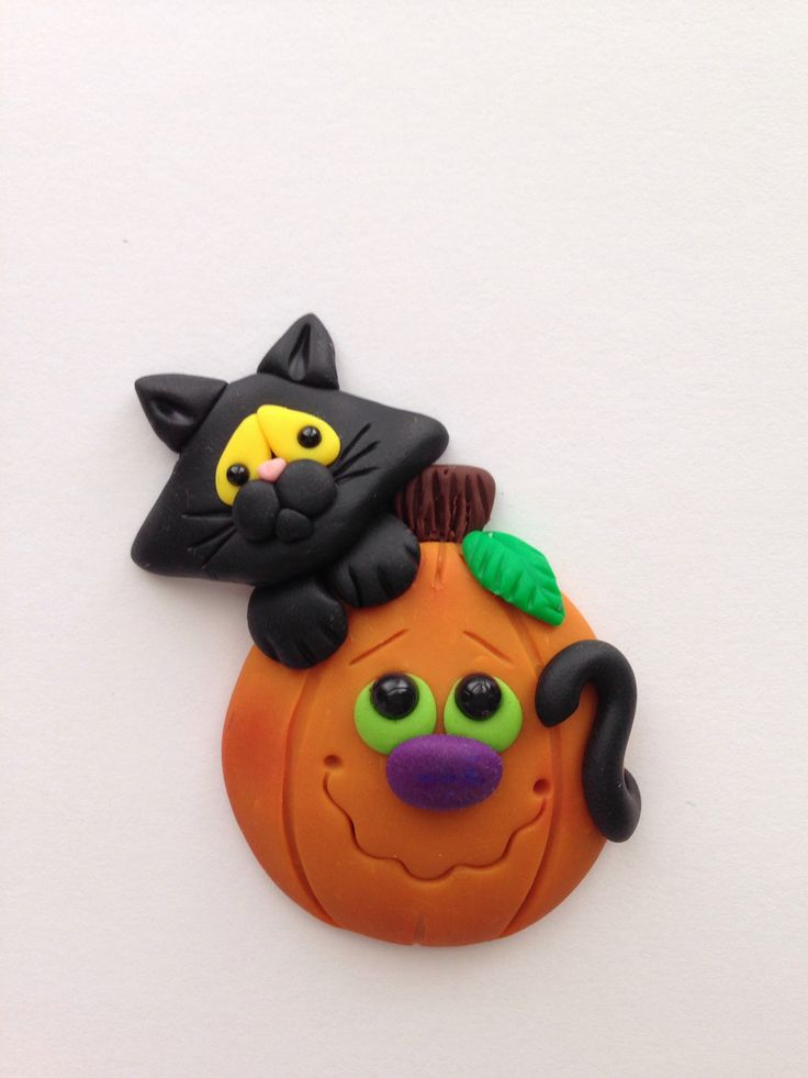 Scaredy cat and pumpkin pin in my Etsy shop https://www.etsy.com/listing/471179290/halloween-black-cat-pumpkin-clay-pin
