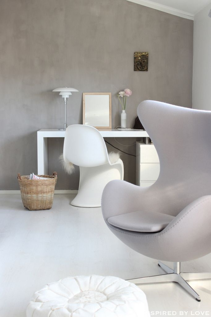 Mid-century modern charm combined with smooth sweep of clean white, the end result is delightful interiors with perfect symmetry. Arne Jacobsen's harmonious Egg Chair was designed with sprawling wing tips and amorphous form, while Verner Panton's S Chair is a study of opposites built from the most exacting design specifications.