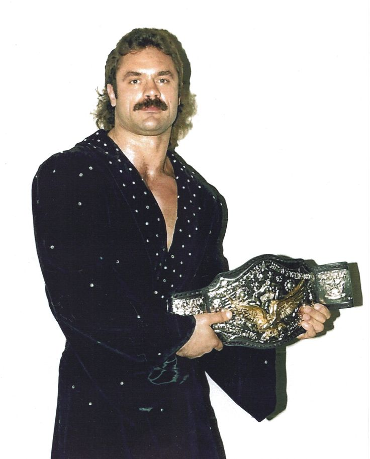 """Richard Erwin """"Rick"""" Rood (December 7, 1958 – April 20, 1999), better known by his ring name """"Ravishing Rick"""" Rude, was an American professional wrestler who performed for many promotions, including World Championship Wrestling (WCW), World Wrestling Federation (WWF), and Extreme Championship Wrestling (ECW). http://en.wikipedia.org/wiki/Rick_Rude"""