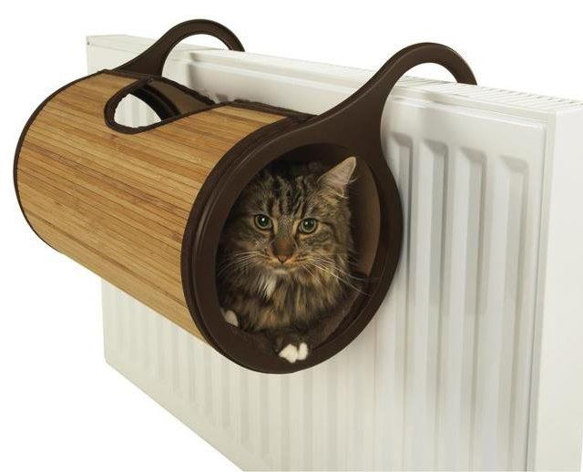 If this truly isn't dangerous and won't catch fire, then this is super cool :)  Bamboo Radiator Cat Bed
