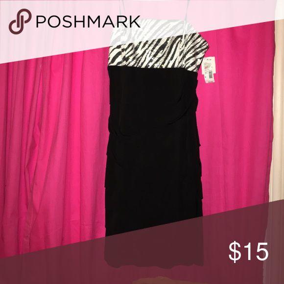 NWT Strapless zebra dress NWT Super cute..tight fitting dress..New with tags..size medium Dresses Mini
