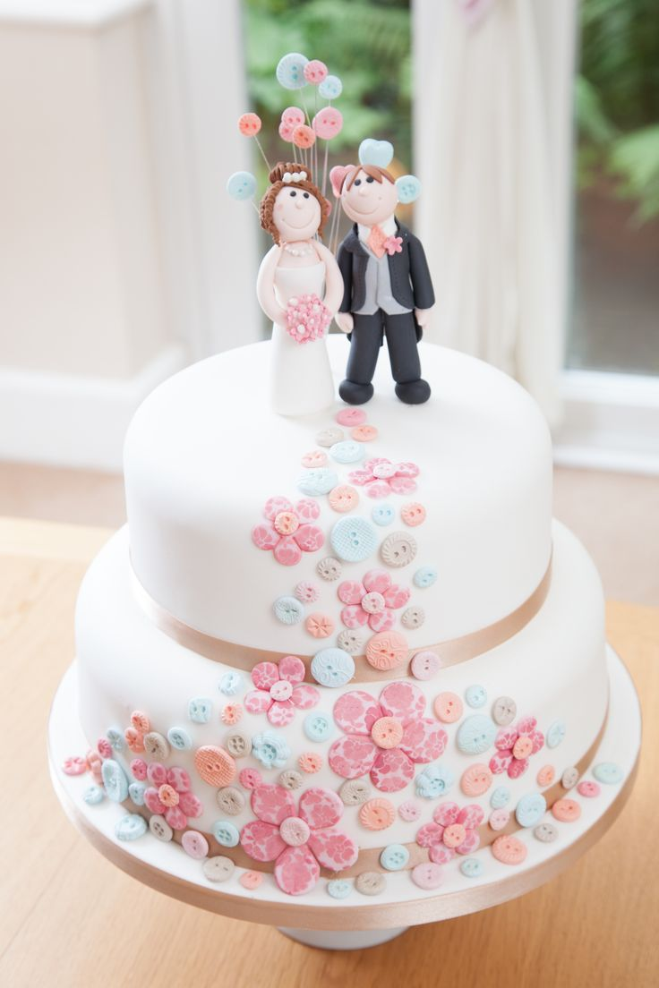 Modern bride and grroom cake. Cascade of flowers and buttons in pretty pastle colours