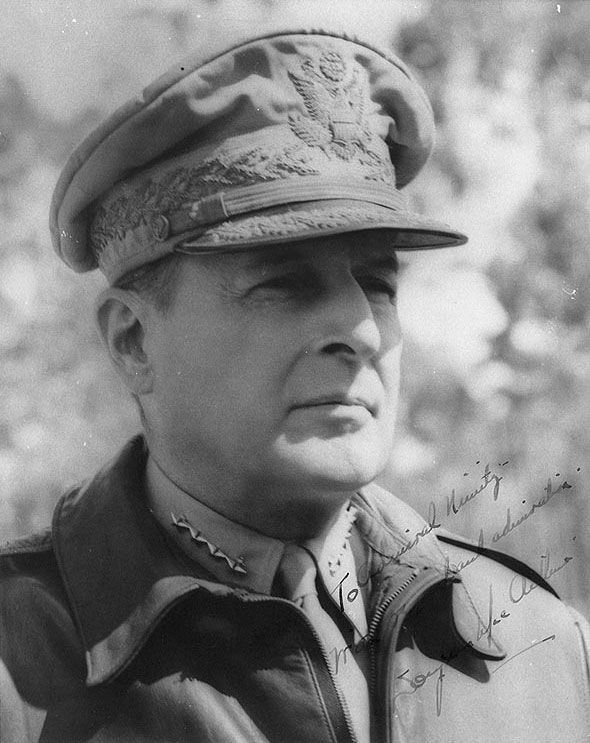 Portrait of MacArthur, circa 1943-1944; text reads 'To Admiral Nimitz.  With regard and admiration.  Douglas MacArthur'