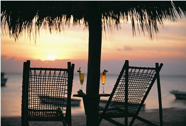 Cocktail hour as the sun sets over the Indian Ocean as you laze dreamily cocooned in comfort at Azura Lodge on Benguerra Island, within Mozambique's southern string of tropical islands.