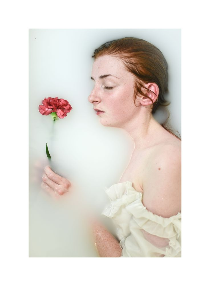 Self-portrait by Sophia Perkins. Milk bath photography.