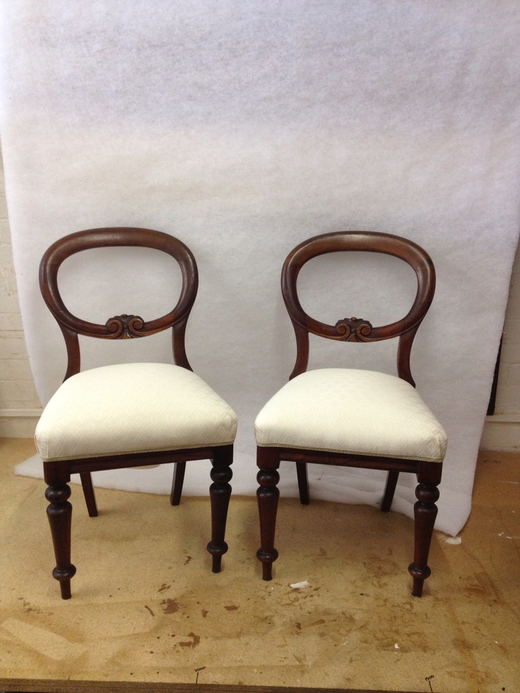 Recovered a pair of chairs in ivory fabric.
