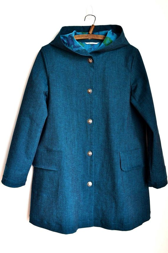 This Spring Coat is made with stretchy denim (cotton/poly blend). It is woven with Black and Blue threads (chambray) which create beautiful and subtle