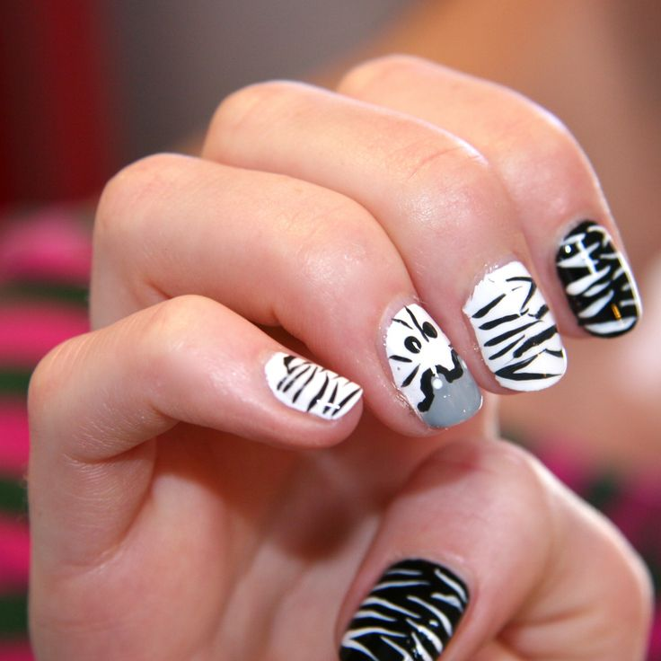 "Who called us Zebras boring anyway!?   We hung out at a cool nail bar this week, totally IN with the ""IN herd"" and bang on trend!!   Check out this ""HOW TO"" VIDEO we made to help you Stripe to Style this festive season. http://youtu.be/6YCdZL8xIlM #KhumbaStyle"