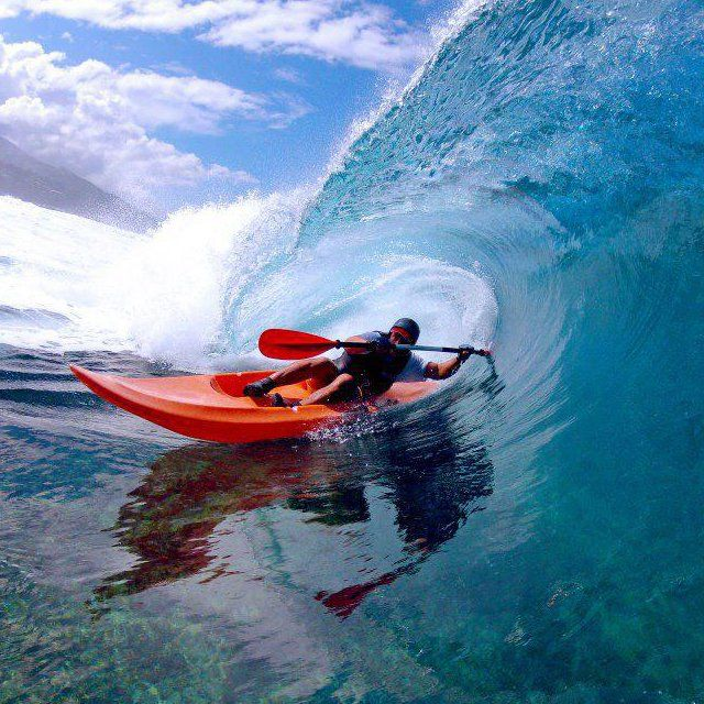 surf kayaking, so fun!  need to learn the eskimo roll!
