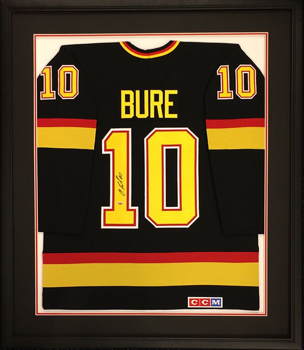 custom framed hockey jersey signed by pavel bure of the vancouver canucks designed and framed