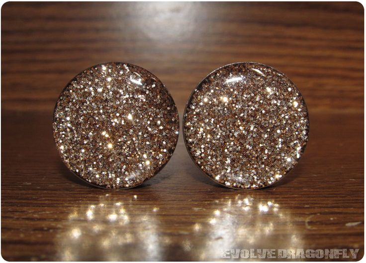 Gold Glitter Plugs - 7/16, 11mm. $17.00 my ears aren't this big yet. But I think I should just buy these now!
